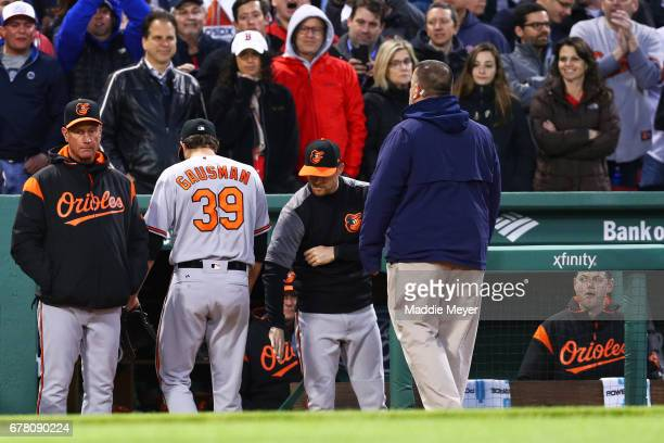 Kevin Gausman of the Baltimore Orioles leaves the field after being ejected for striking Xander Bogaerts of the Boston Red Sox with a pitch during...