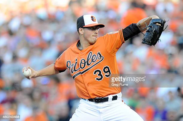 Kevin Gausman of the Baltimore Orioles pitches in the first inning against the Oakland Athletics at Oriole Park at Camden Yards on June 7 2014 in...