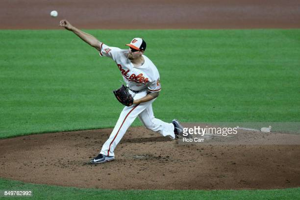 Kevin Gausman of the Baltimore Orioles pitches to a Boston Red Sox batter in the fourth inning at Oriole Park at Camden Yards on September 19 2017 in...