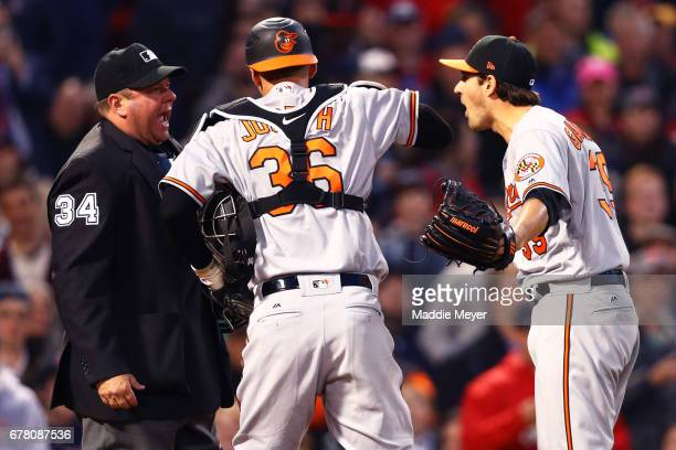 Kevin Gausman of the Baltimore Orioles reacts after being ejected by umpire Sam Holbrook after hitting Xander Bogaerts of the Boston Red Sox with a...