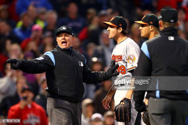 Kevin Gausman of the Baltimore Orioles reacts after being ejected for hitting Xander Bogaerts of the Boston Red Sox with a pitch during the second...