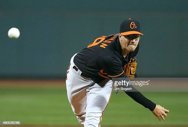 Kevin Gausman of the Baltimore Orioles throws against the Boston Red Sox in the first inning at Fenway Park on September 25 2015 in Boston...