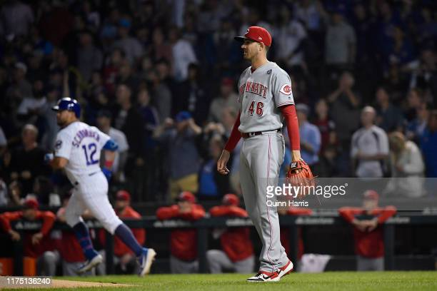Kevin Gausman of the Cincinnati Reds looks on after giving up a three run home run in the first inning Kyle Schwarber of the Chicago Cubs at Wrigley...