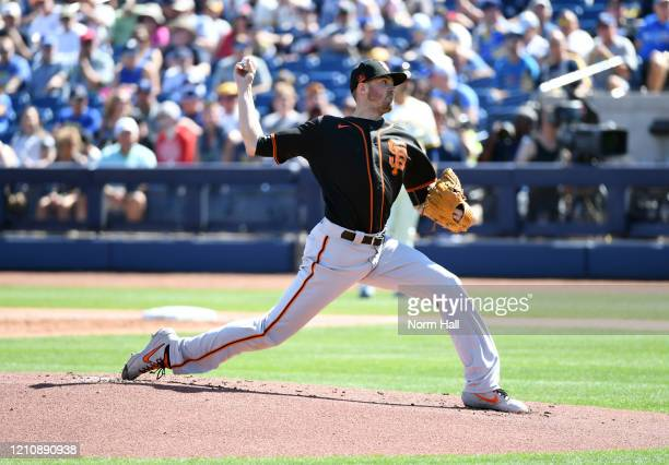 Kevin Gausman of the San Francisco Giants delivers a pitch against the Milwaukee Brewers during a spring training game at American Family Fields of...