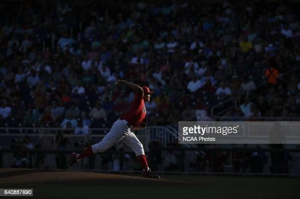 Kevin Ginkel of University of Arizona delivers a pitch against Coastal Carolina University during the Division I Men's Baseball Championship held at...
