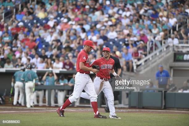 Kevin Ginkel of University of Arizona jogs back to the dugout against Coastal Carolina University during the Division I Men's Baseball Championship...