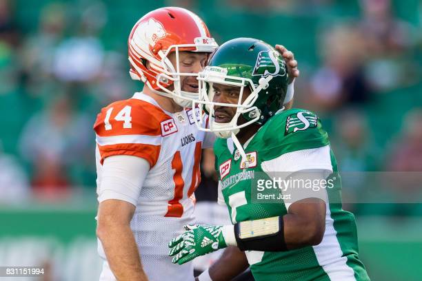 Kevin Glenn of the Saskatchewan Roughriders and Travis Lulay of the BC Lions greet each other on the field during pregame warmup for the game between...