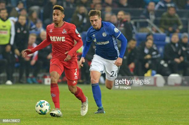 Kevin Goden of Koeln and Bastian Oczipka of Schalke battle for the ball during the Bundesliga match between FC Schalke 04 and 1 FC Koeln at...