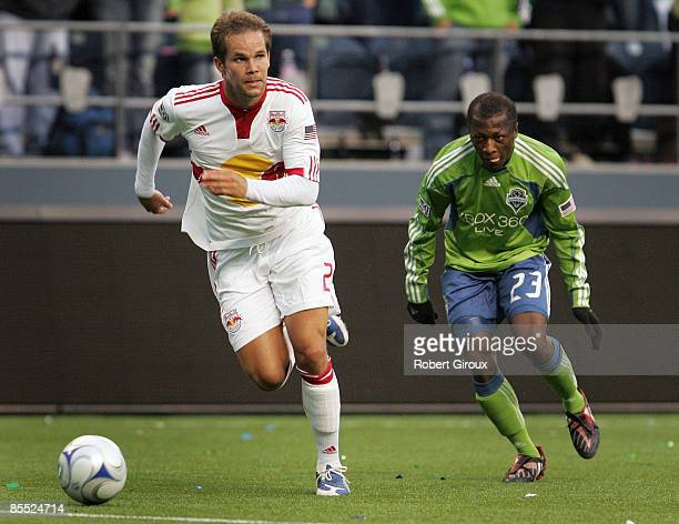 Kevin Goldthwaite of the New York Red Bulls and Sanna Nyassi of the Seattle Sounders FC chase the ball in the first half of their opening match at...