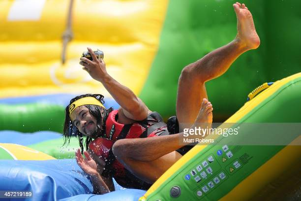 Kevin Gordon falls on the obstacle course during a Gold Coast Titans NRL preseason training session at aquaSplash Water Park on December 17 2013 on...
