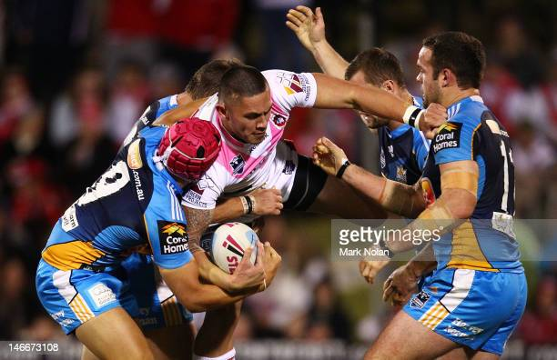 Kevin Gordon of the Dragons is tackled during the round 16 NRL match between the St George Illawarra Dragons and the Gold Coast Titans at WIN Stadium...