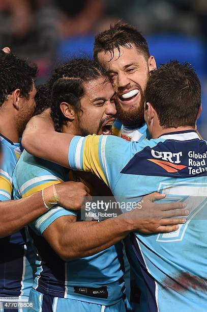 Kevin Gordon of the Titans celebrates scoring a try with team mates during the round 14 NRL match between the Gold Coast Titans and the Canterbury...