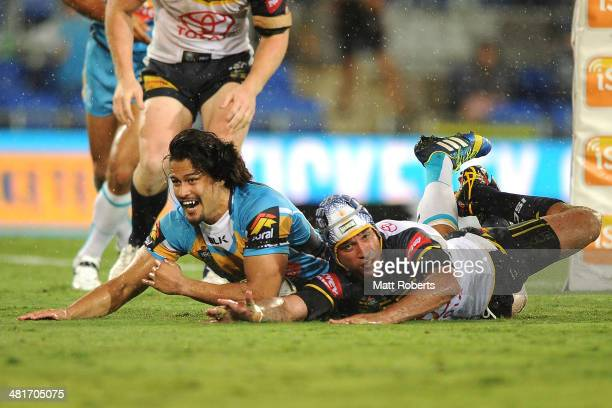 Kevin Gordon of the Titans scores a try during the round four NRL match between the Gold Coast Titans and North Queensland Cowboys at Cbus Super...