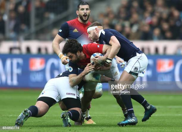 Kevin Gourdon of France is tackled by Zander Fagerson and Greig Laidlaw of Scotland during the RBS Six Nations match between France and Scotland at...