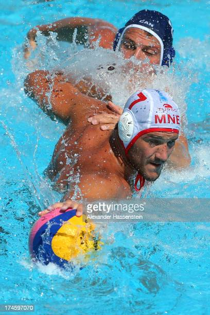 Kevin Graham of canada in action against Mladan Janovic of Montenegro during the Men's Water Polo quarterfinals qualification match between...