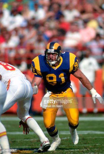 Kevin Greene of the Los Angeles Rams pursues the play against the Kansas City Chiefs during an NFL Football game November 10 1991 at Anaheim Stadium...