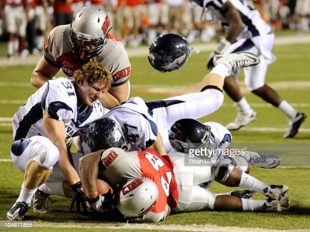Kevin Grimes of the Nevada Reno Wolf Pack loses his helmet as Wolf Pack defenders tackle Bradley Randle of the UNLV Rebels at Sam Boyd Stadium...