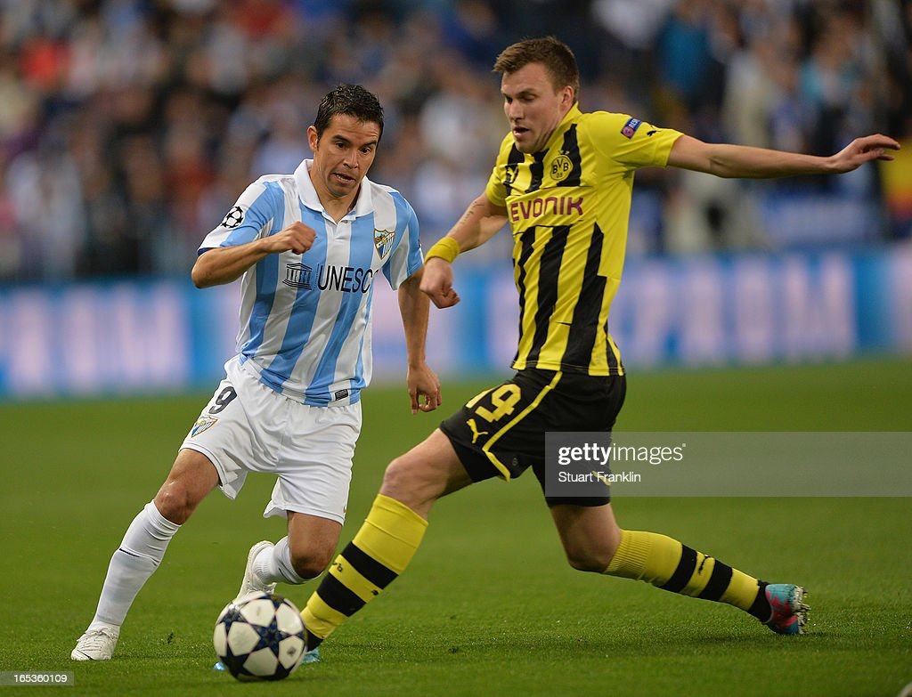 Malaga cf v borussia dortmund uefa champions league quarter final kevin groflkreutz of dortmund challenges for the ball withjavier saviola of malaga during the uefa champion voltagebd Choice Image