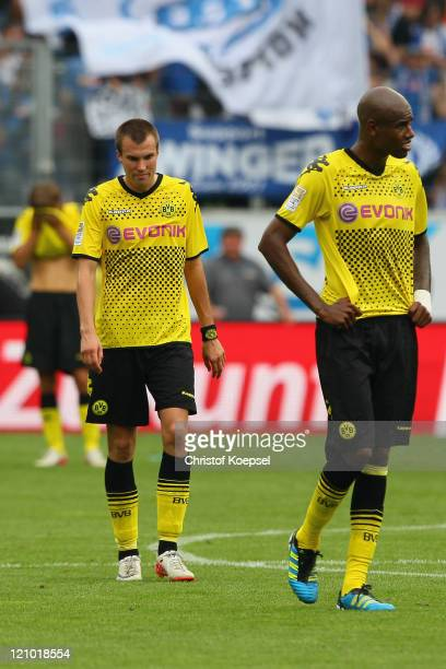 Kevin Grosskreutz and Felipe Santana of Dortmund look dejectedafter losing 0-1 the Bundesliga macht between TSG 1899 Hoffenheim and Borussia Dortmund...