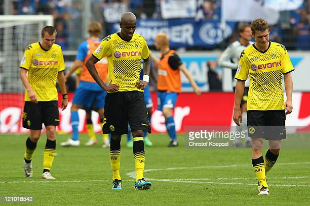 Kevin Grosskreutz, Felipe Santana and Lukasz Piszczek of Dortmundlook dejectedafter losing 0-1 the Bundesliga macht between TSG 1899 Hoffenheim and...
