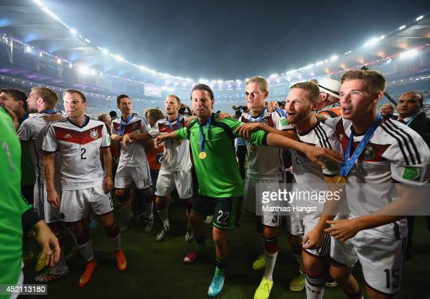 Kevin Grosskreutz Julian Draxler Benedikt Hoewedes Roman Weidenfeller Matthias Ginter Shkodran Mustafi and Erik Durm of Germany celebrate after...