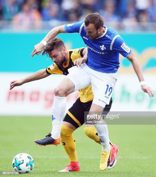 Kevin Grosskreutz of Darmstadt is challenged by Aias Aosman of Dresden during the Second Bundesliga match between SV Darmstadt 98 and SG Dynamo...