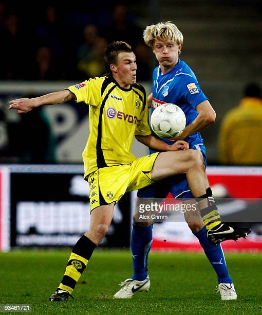 Kevin Grosskreutz of Dortmund and Andreas Beck of Hoffenheim battle for the ball during the Bundesliga match between 1899 Hoffenheim and Borussia...