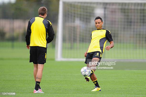 Kevin Grosskreutz of Dortmund and team mate Antonio da Silva play with a ball during a training session at the Dortmund Brackel training ground ahead...
