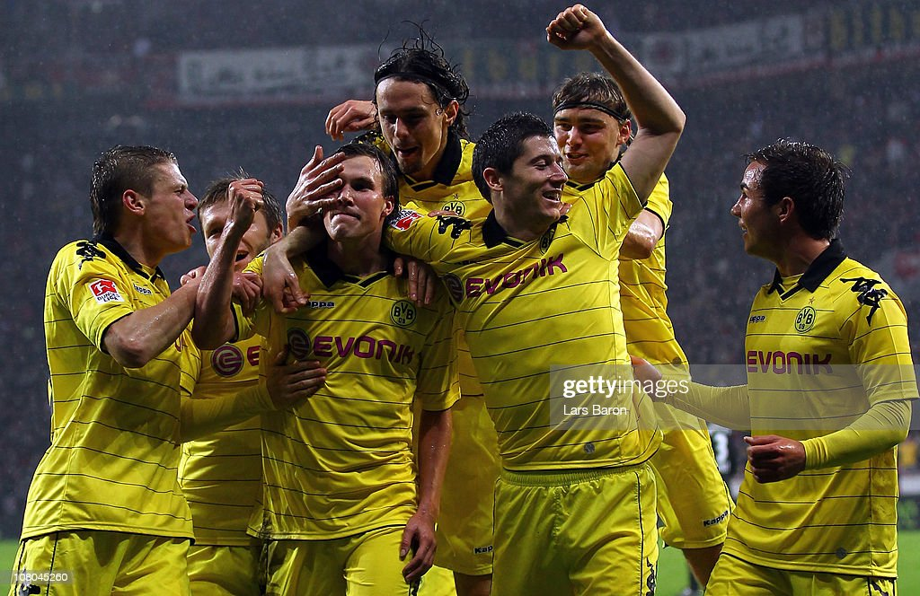Kevin Grosskreutz of Dortmund celebrates with team mates after scoring his teams second goal during the Bundesliga match between Bayer Leverkusen and Borussia Dortmund at BayArena on January 14, 2011 in Leverkusen, Germany.
