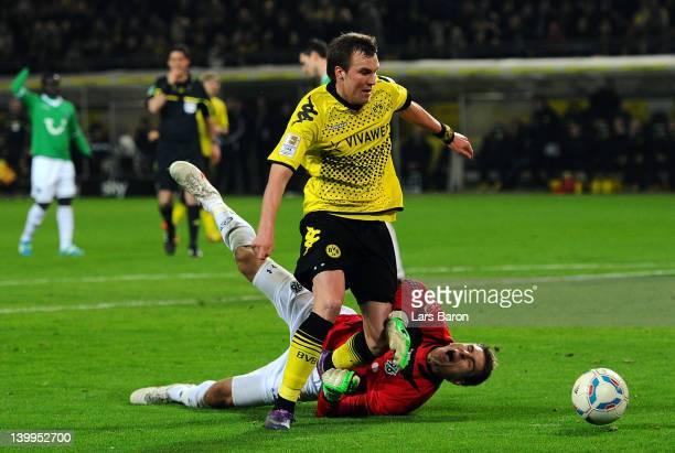 Kevin Grosskreutz of Dortmund is challenged by goalkeeper Ron Robert Zieler of Hannover during the Bundesliga match between Borussia Dortmund and...