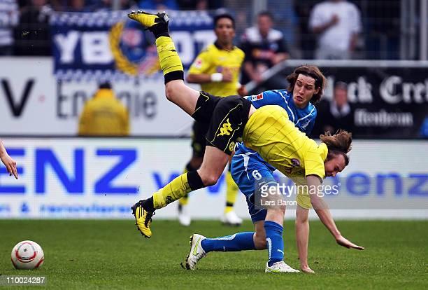 Kevin Grosskreutz of Dortmund is challenged by Sebastian Rudy of Hoffenheim during the Bundesliga match between 1899 Hoffenheim and Borussia Dortmund...