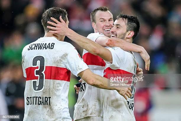 Kevin Grosskreutz of Stuttgart celebrates winning with his team mates Lukas Rupp and Daniel Schwaab after the Bundesliga match between VfB Stuttgart...