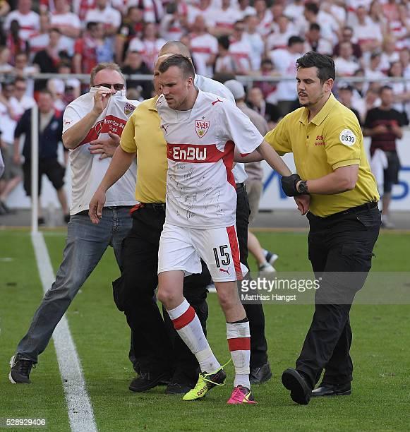 Kevin Grosskreutz of Stuttgart is guided to the dressing room after the Bundesliga match between VfB Stuttgart and 1 FSV Mainz 05 at MercedesBenz...