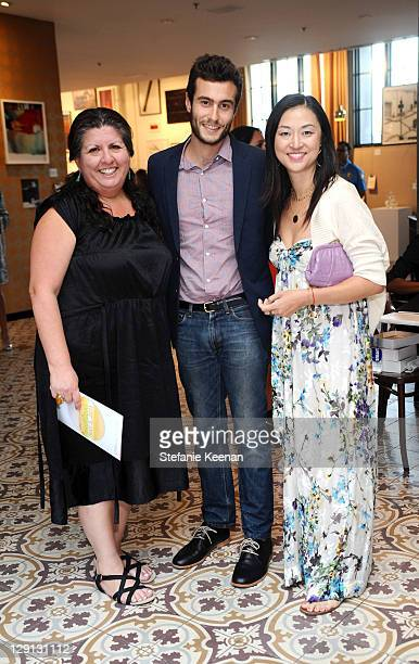 Kevin Gruenberg and Christine Y Kim attend LAND Art Auction And Benefit Party at Palihouse on May 5 2011 in West Hollywood California