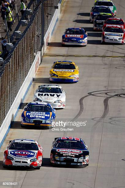Kevin Hamlin driver of the Vector Security Dodge leads a pack of cars during the NASCAR Nationwide Series Camping World RV 200 at Dover International...