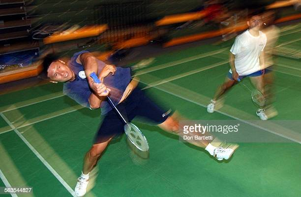 Kevin Han, 30 of Orange follows through on an overhead smash during a workout at the Orange County Badminton Club on Main St. In Orange. Han and his...