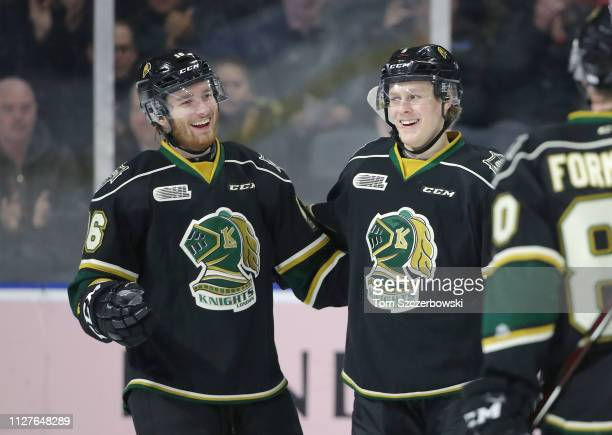 Kevin Hancock of the London Knights celebrates his goal with Adam Boqvist in the first period during OHL game action against the Guelph Storm at...