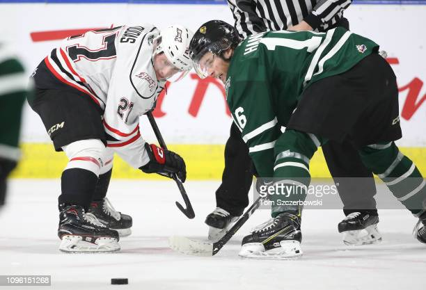 Kevin Hancock of the London Knights wins a faceoff against Aidan Dudas of the Owen Sound Attack in the first period during OHL game action at...