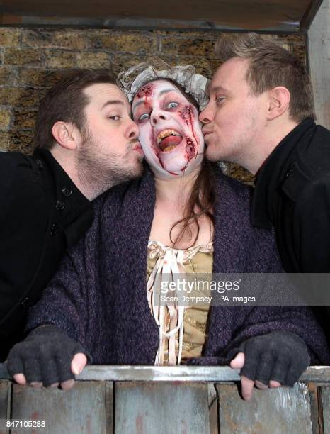 Kevin Haney and Karl Roberts both from London kiss Pretty Polly the Plague Victim in the London Dungeon Kiss of Death booth which has opened for...