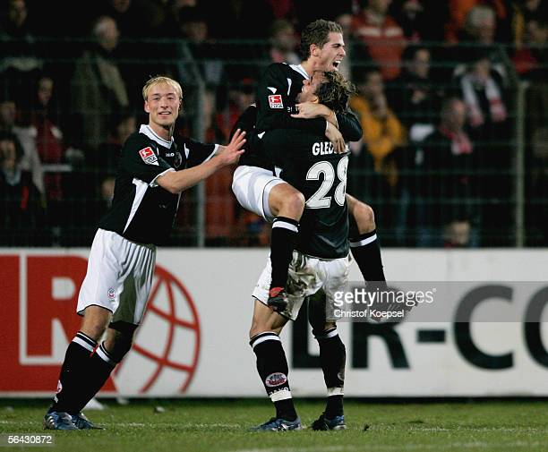 Kevin Hansen of Rostock celebrates the first goal with Tim Sebastian and Gledson during the Second Bundesliga match between LR Ahlen and Hansa...