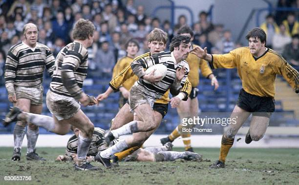 Kevin Harkin of Hull takes on the Castleford defence during the State Express Rugby League Challenge Cup SemiFinal between Castleford and Hull at...