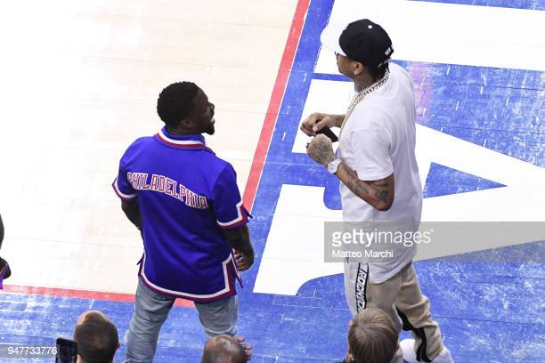 Kevin Hart and Allen Iverson attend the game between the Miami Heat and the Philadelphia 76ers in game two of round one of the 2018 NBA Playoffs on...