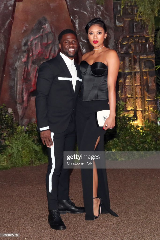 Kevin Hart (L) and Eniko Parrish attend the premiere of Columbia Pictures' 'Jumanji: Welcome To The Jungle' on December 11, 2017 in Hollywood, California.