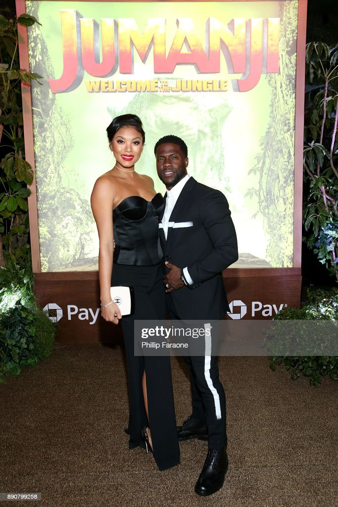 Kevin Hart (R) and Eniko Parrish attend the premiere of Columbia Pictures' 'Jumanji: Welcome To The Jungle' on December 11, 2017 in Hollywood, California.