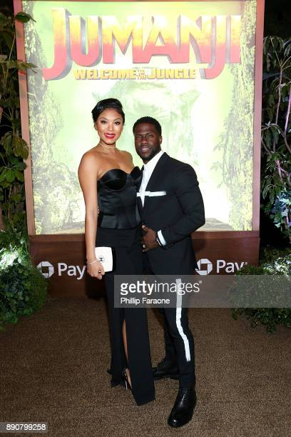 Kevin Hart and Eniko Parrish attend the premiere of Columbia Pictures' Jumanji Welcome To The Jungle on December 11 2017 in Hollywood California