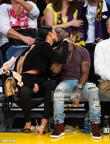 Kevin Hart and Eniko Parrish kiss at a basketball game between the Golden State Warriors and the Los Angeles Lakers at Staples Center on December 23...