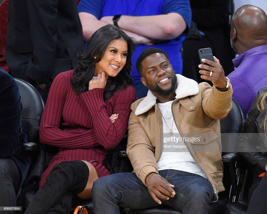Kevin Hart (R) and Eniko Parrish take a selfie3 at a basketball game between the Los Angeles Clippers and the Los Angeles Lakers at Staples Center on December 25, 2016 in Los Angeles, California.