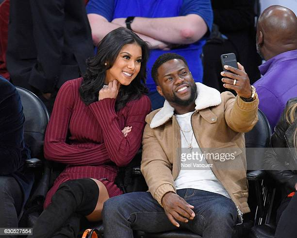 Kevin Hart and Eniko Parrish take a selfie3 at a basketball game between the Los Angeles Clippers and the Los Angeles Lakers at Staples Center on...