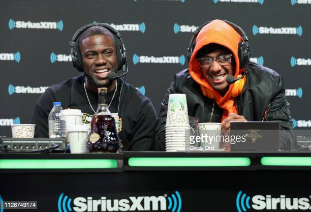 Kevin Hart and Nick Cannon attend SiriusXM at Super Bowl LIII Radio Row on February 01, 2019 in Atlanta, Georgia.