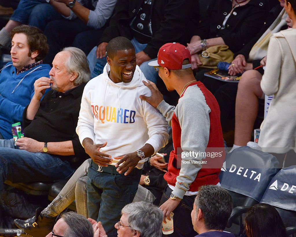 Kevin Hart (L) and T.I. attend a basketball game between the Utah Jazz and the Los Angeles Lakers at Staples Center on January 25, 2013 in Los Angeles, California.